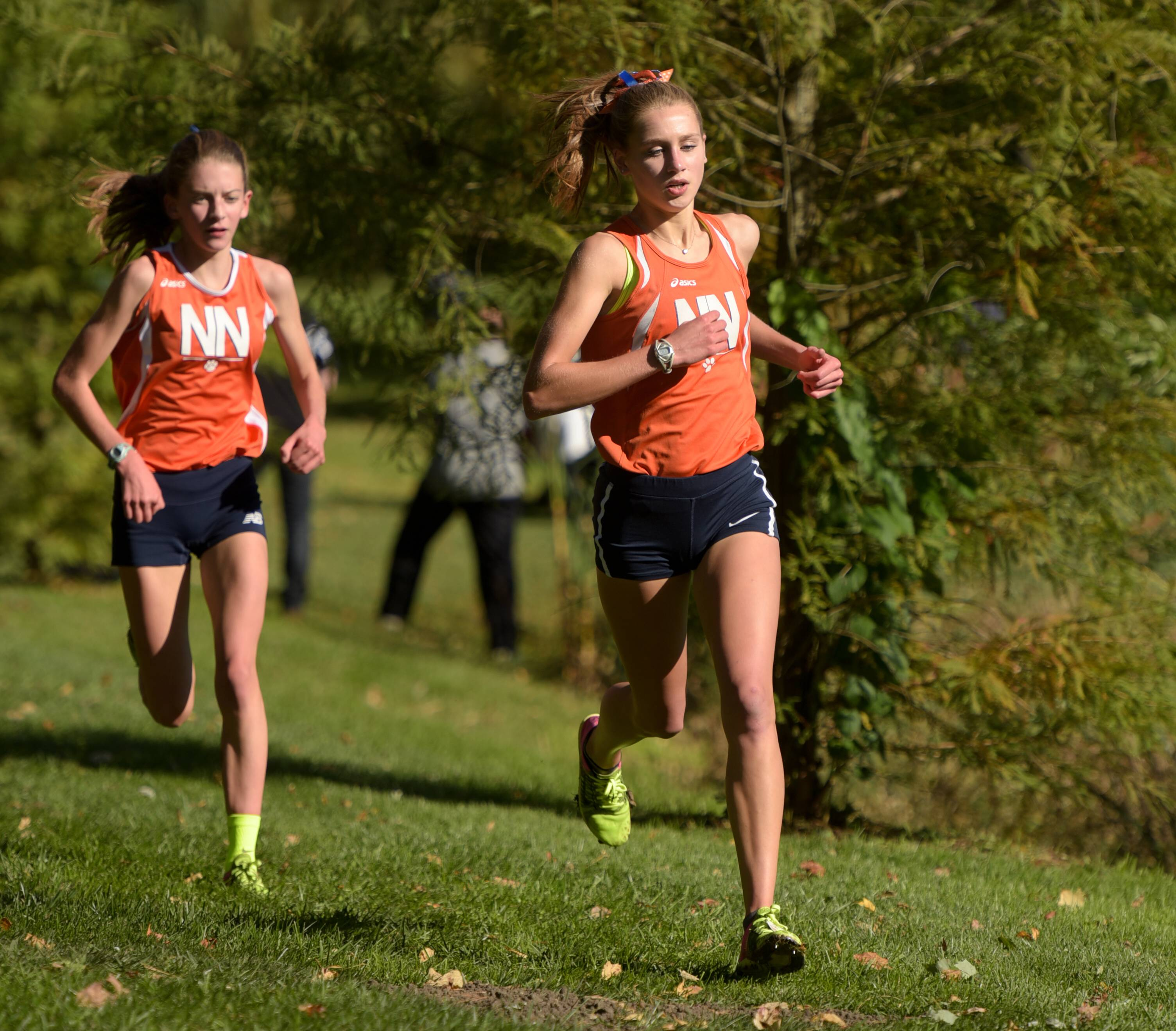 Naperville North's Alex Morris and Sarah Schmitt run the course during DuPage Valley Conference girls cross country meet at St. James Farm forest preserve on October 16, 2017. Schmitt and Morris placed first and second in the meet.