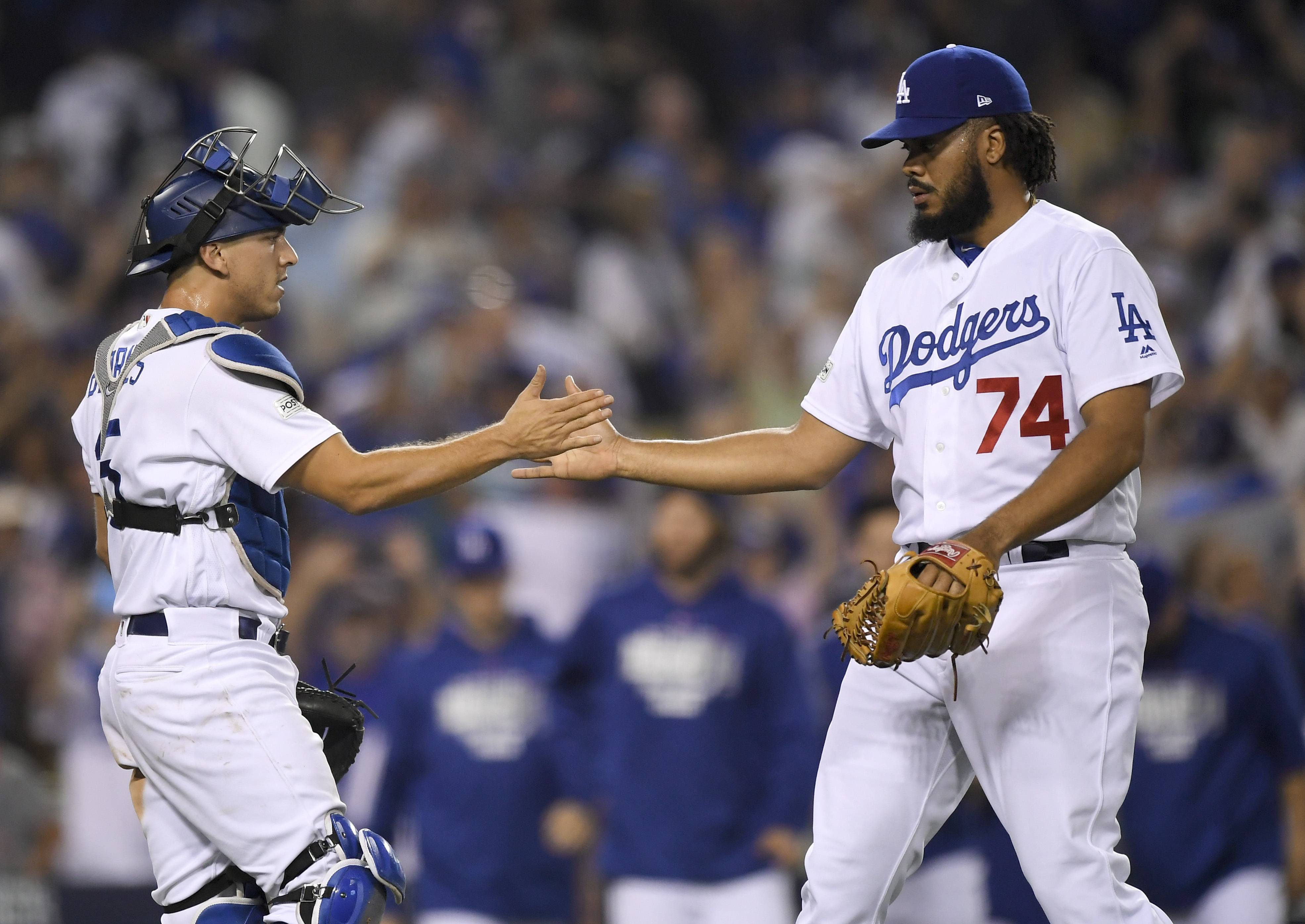 Los Angeles Dodgers relief pitcher Kenley Jansen, right, celebrates the team's 5-2 win Saturday with catcher Austin Barnes after Game 1 of the NLCS against the Chicago Cubs in Los Angeles.