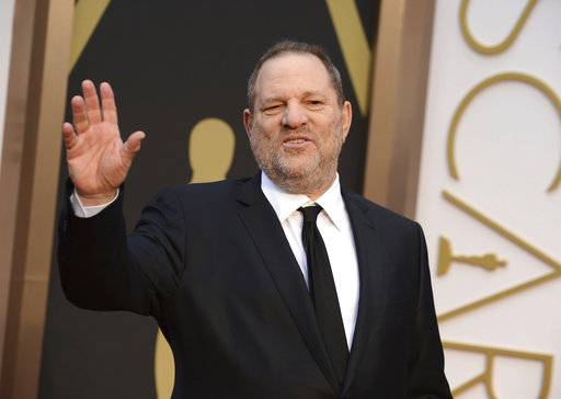 FILE - In this March 2, 2014 file photo, Harvey Weinstein arrives at the Oscars in Los Angeles. In the wake of sexual harassment and abuse allegations against Weinstein, many in Hollywood are calling for sweeping changes to the entertainment industry to prevent the mistreatment of women. Among some of the changes experts recommend are an independent agency to investigate harassment complaints and preventing sexual harassment allegations from being hidden behind non-disclosure agreements. (Photo by Jordan Strauss/Invision/AP, File)