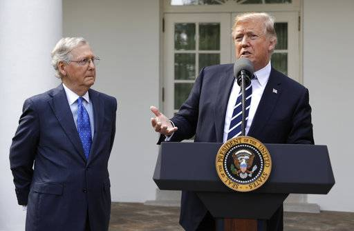 President Donald Trump speaks with Senate Majority Leader Mitch McConnell, R-Ky., in the Rose Garden at the White House, Monday, Oct. 16, 2017, in Washington. (AP Photo/Evan Vucci)