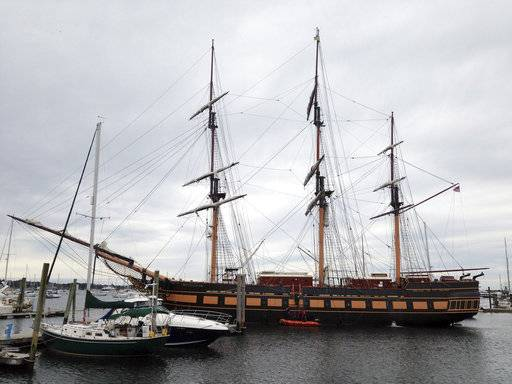 Tall ship SSV Oliver Hazard Perry sits in the Newport Harbor, Monday, Oct. 16, 2017, in Newport, R.I. U.S. Coast Guard officials said the ship was leaving a seafood festival Sunday evening when it lost power and began to drift in the harbor, hitting several boats. There were no injuries and minimal damage. (AP Photo/Jennifer McDermott)