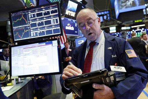 Trader Frederick Reimer works on the floor of the New York Stock Exchange, Monday, Oct. 16, 2017. U.S. stocks edged higher in early trading Monday, adding to the market's five straight weeks of gains. (AP Photo/Richard Drew)