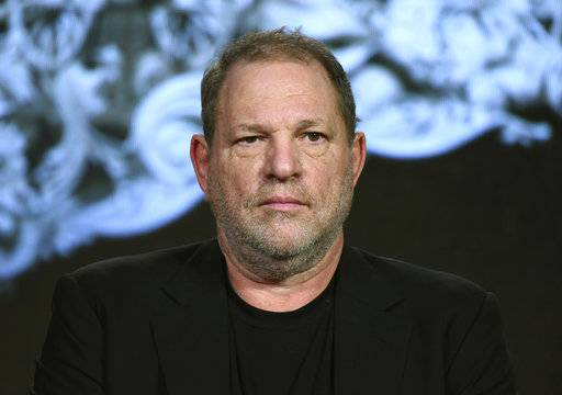 "FILE - In this Jan. 6, 2016, file photo, producer Harvey Weinstein participates in a panel at the A&E 2016 Winter TCA in Pasadena, Calif. The Weinstein Co., mired in a sex scandal, may be putting itself up for sale. The company said Monday, Oct. 16, 2017, that it is getting an immediate cash infusion from Colony Capital and is in negotiations for the potential sale of all or a significant portion of the movie studio responsible for films like ""Shakespeare in Love,"" and ""Gangs of New York."" (Photo by Richard Shotwell/Invision/AP, File)"