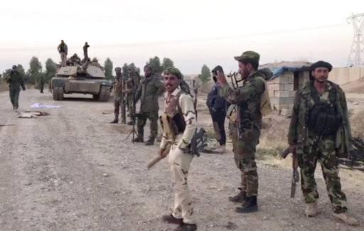 The Latest: Iraqi militias claim success in Kirkuk