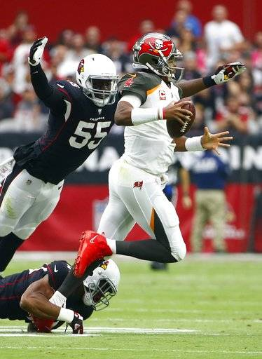 Tampa Bay Buccaneers quarterback Jameis Winston, right, is tackled by Arizona Cardinals outside linebacker Chandler Jones (55) and inside linebacker Haason Reddick (43) during the first half of an NFL football game Sunday, Oct. 15, 2017, in Glendale, Ariz. Winston was injured on the play. (AP Photo/Ralph Freso)