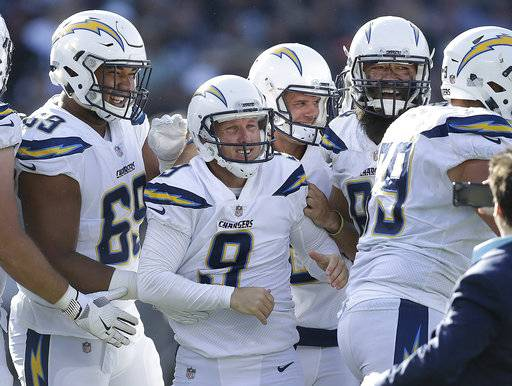 Los Angeles Chargers kicker Nick Novak (9) celebrates with teammates after kicking the game winning field goal against the Oakland Raiders during the second half of an NFL football game in Oakland, Calif., Sunday, Oct. 15, 2017. (AP Photo/Ben Margot)
