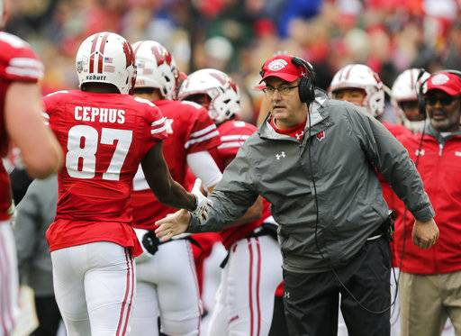 Wisconsin coach Paul Chryst greets wide receiver Quintez Cephus after Cephus' touchdown against Purdue during the first half of an NCAA college football game, Saturday, Oct. 14, 2017, in Madison, Wis. (AP Photo/Andy Manis)