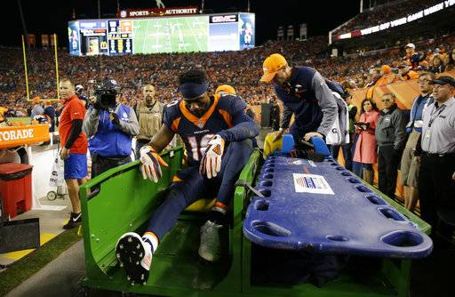 Denver Broncos wide receiver Emmanuel Sanders is carted off the field after an injury during the second half of an NFL football game against the New York Giants, Sunday, Oct. 15, 2017, in Denver. (AP Photo/Jack Dempsey)
