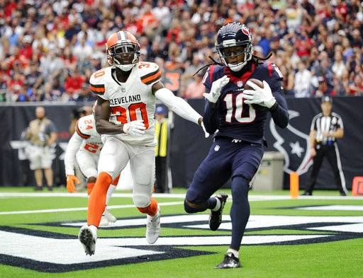 Cleveland Browns cornerback Jason McCourty (30) is unable to stop Houston Texans wide receiver DeAndre Hopkins (10) from catching a touchdown pass in the second half of an NFL football game, Saturday, Oct. 14, 2017, in Houston. (AP Photo/Eric Christian Smith)
