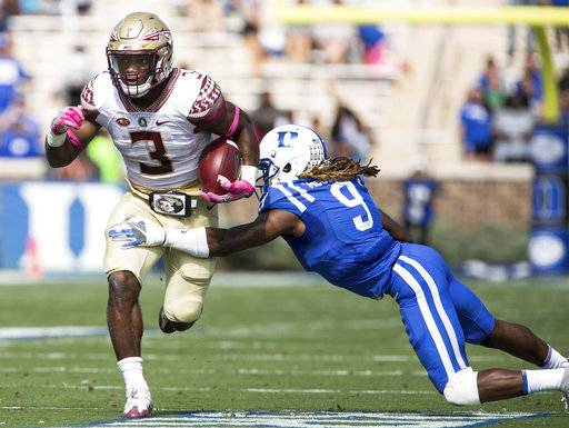 Florida State's Cam Akers (3) carries the ball as Jeremy McDuffie (9) attempts a tackle during the first half of an NCAA college football game in Durham, N.C., Saturday, Oct. 14, 2017. (AP Photo/Ben McKeown)