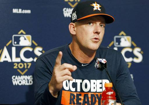 Houston Astros manager A.J. Hinch gestures during a news conference before an American League Championship Series baseball workout day in New York, Sunday, Oct. 15, 2017. (AP Photo/Kathy Willens)