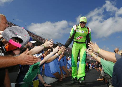 Dale Earnhardt Jr. greets fans before a NASCAR Talladega auto race at Talladega Superspeedway, Sunday, Oct. 15, 2017, in Talladega, Ala. (AP Photo/Brynn Anderson)