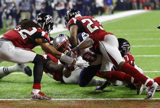 "FILE - In this Feb. 5, 2017, file photo, New England Patriots' James White scores the winning touchdown between Atlanta Falcons' Jalen Collins, left, and Robert Alford during overtime of the NFL Super Bowl 51 football game, in Houston. Dan Quinn insists the Falcons are not ""facing any demons� this week when they visit the Patriots, bringing back memories of the blown 28-3 lead in last season's Super Bowl loss to New England.(AP Photo/Elise Amendola, File)"