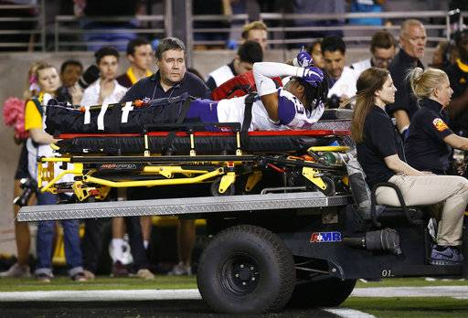Washington defensive back Jordan Miller (23) is carted off the field due to injury during the second half of an NCAA college football game against Arizona State Saturday, Oct. 14, 2017, in Tempe, Ariz. Arizona State defeated Washington 13-7. (AP Photo/Ross D. Franklin)