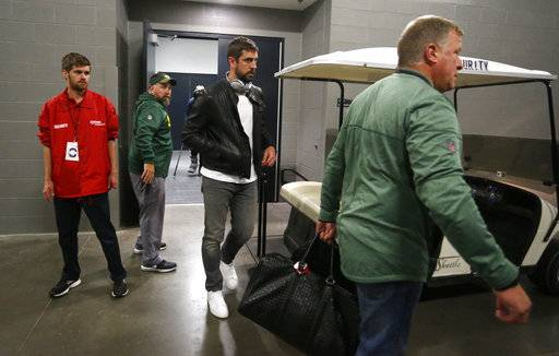 Green Bay Packers quarterback Aaron Rodgers, center, leaves the locker room after an NFL football game against the Minnesota Vikings in Minneapolis, Sunday, Oct. 15, 2017. Rodgers broke his collarbone in the first half. (AP Photo/Bruce Kluckhohn)