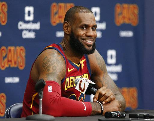 FILE - This Sept. 25, 2017 file photo shows Cleveland Cavaliers' LeBron James answering questions during the NBA basketball team media day in Independence, Ohio. James tested his injured left ankle during a portion of practice Sunday, Oct. 15, 2017 but it's still not known if he'll play in Cleveland's season opener. (AP Photo/Ron Schwane, file)