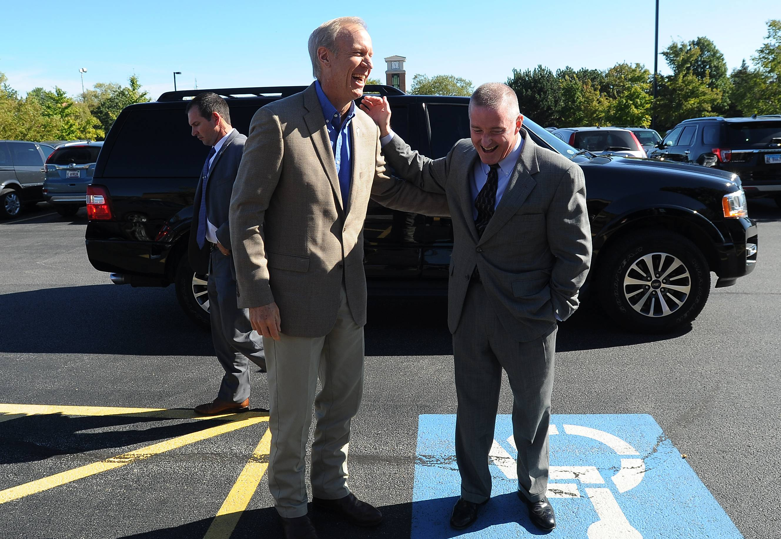 Gov. Bruce Rauner and Elk Grove Village Mayor Craig Johnson share a laugh before they addressed business owners at the Made in Elk Grove Manufacturing and Technology Expo on Tuesday.