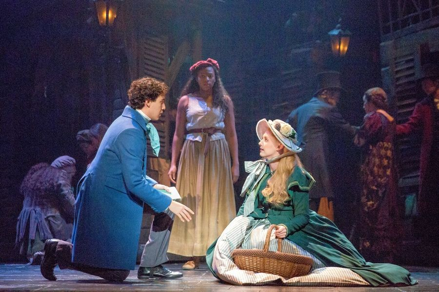 "To the dismay of Eponine (Phoenix Best), center, Marius (Joshua Grosso) is smitten with Cosette (Jillian Butler) in Laurence Connor and James Powell's refreshed production of the musical ""Les Miserables"" at Chicago's Cadillac Palace Theatre."