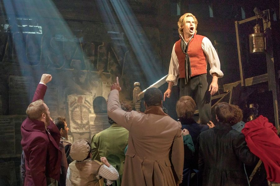 "Enjolras (Matt Shingledecker, with raised arm) leads the student uprising in ""Les Miserables,"" running through Oct. 29 at the Cadillac Palace Theatre."