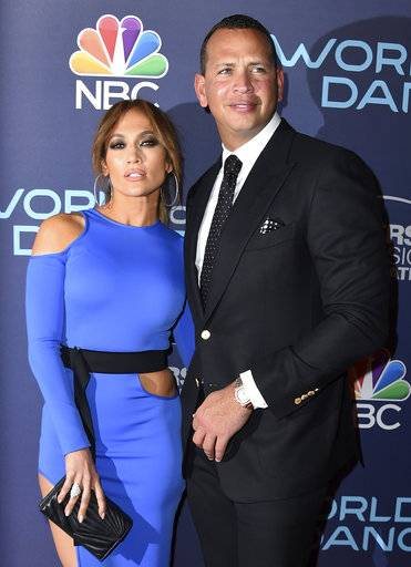 "FILE - This Sept. 19, 2017 file photo Jennifer Lopez, left, and Alex Rodriguez arrive at the ""World of Dance"" Celebration at Delilah in West Hollywood, Calif. Lopez, her ex-husband Marc Anthony and her current boyfriend Rodriguez have raised more than $35 million for Puerto Rico hurricane relief. A spokeswoman said in a statement Tuesday, Oct. 17, 2017, that the two singers and the retired baseball superstar raised the money in donations, pledges, and their own contributions. (Photo by Jordan Strauss/Invision/AP, File)"