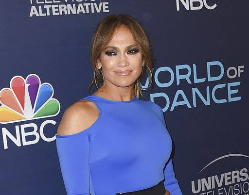 "FILE - In this Sept. 19, 2017 file photo, actress and singer Jennifer Lopez arrives at the ""World of Dance"" celebration in West Hollywood, Calif. Lopez and Alex Rodriguez have raised $26 million for Puerto Rico disaster relief, with another $9 million raised by a benefit show. The two hosted ""One Voice: Somos Live!� on Saturday with Marc Anthony. (Photo by Jordan Strauss/Invision/AP, File)"