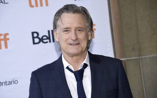 "FILE - In a Sunday, Sept. 10, 2017 file photo, Bill Pullman attends a premiere for ""Battle of the Sexes"" on day 4 of the Toronto International Film Festival at the Ryerson Theatre, in Toronto. On Saturday, Oct. 14, 2017, the ""Independence Day� actor was the recipient of the Excellence in Acting Award at the Woodstock Film Festival last Saturday night in Kingston, in New York's Hudson Valley. The Daily Freeman reports that after being handed the award, Pullman placed it on a shelf attached to the lectern on the stage. As Pullman began to speak, he jostled the lectern, causing the award to topple to the floor and break in two pieces. (Photo by Evan Agostini/Invision/AP, File)"