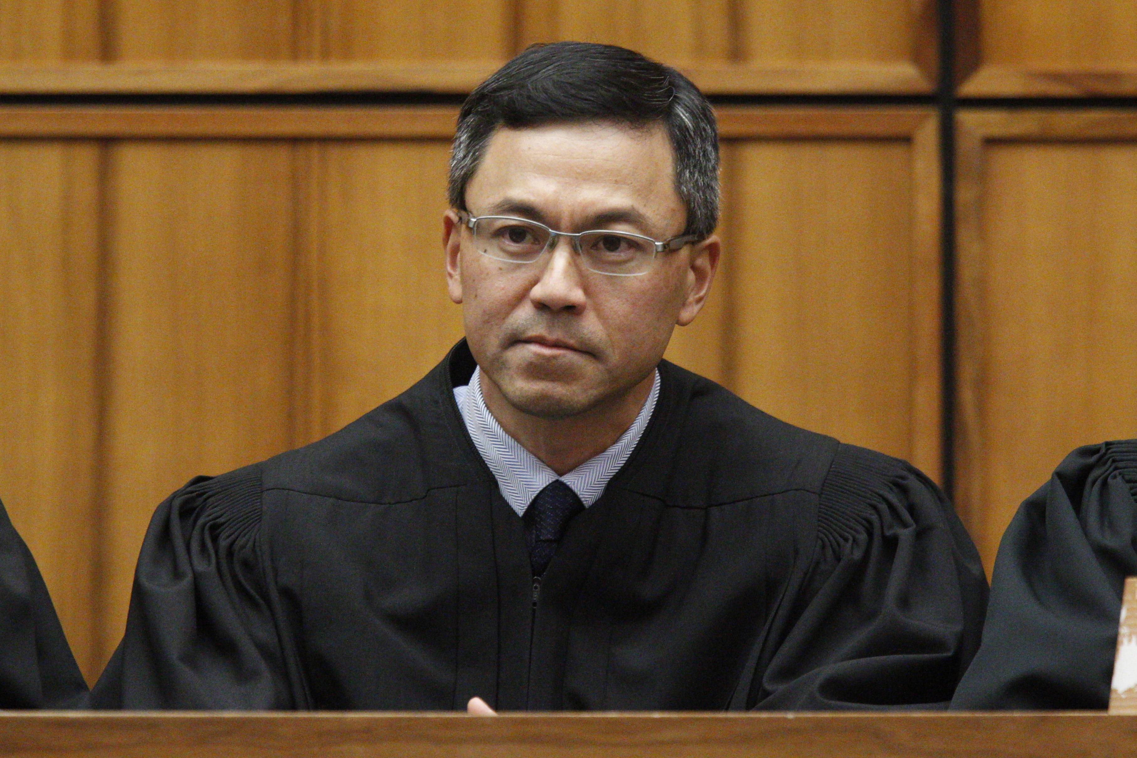 FILE - This Dec. 2015 file photo shows U.S. District Judge Derrick Watson in Honolulu. Watson on Tuesday, Oct. 17, 2017, blocked the Trump administration from enforcing its latest travel ban, just hours before it was set to take effect. (George Lee /The Star-Advertiser via AP, File)