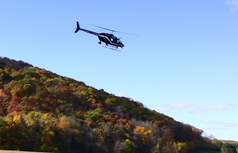 A police helicopter scans a bluff along the Baraboo River in Wisconsin on a bright October day in 2007, looking for Buffalo Grove teen Lee Cutler. Divers searched the river, while dogs and searchers with heat-seeking devices looked in the fields near where his locked car and other personal items were found. A decade later, Cutler is still missing.
