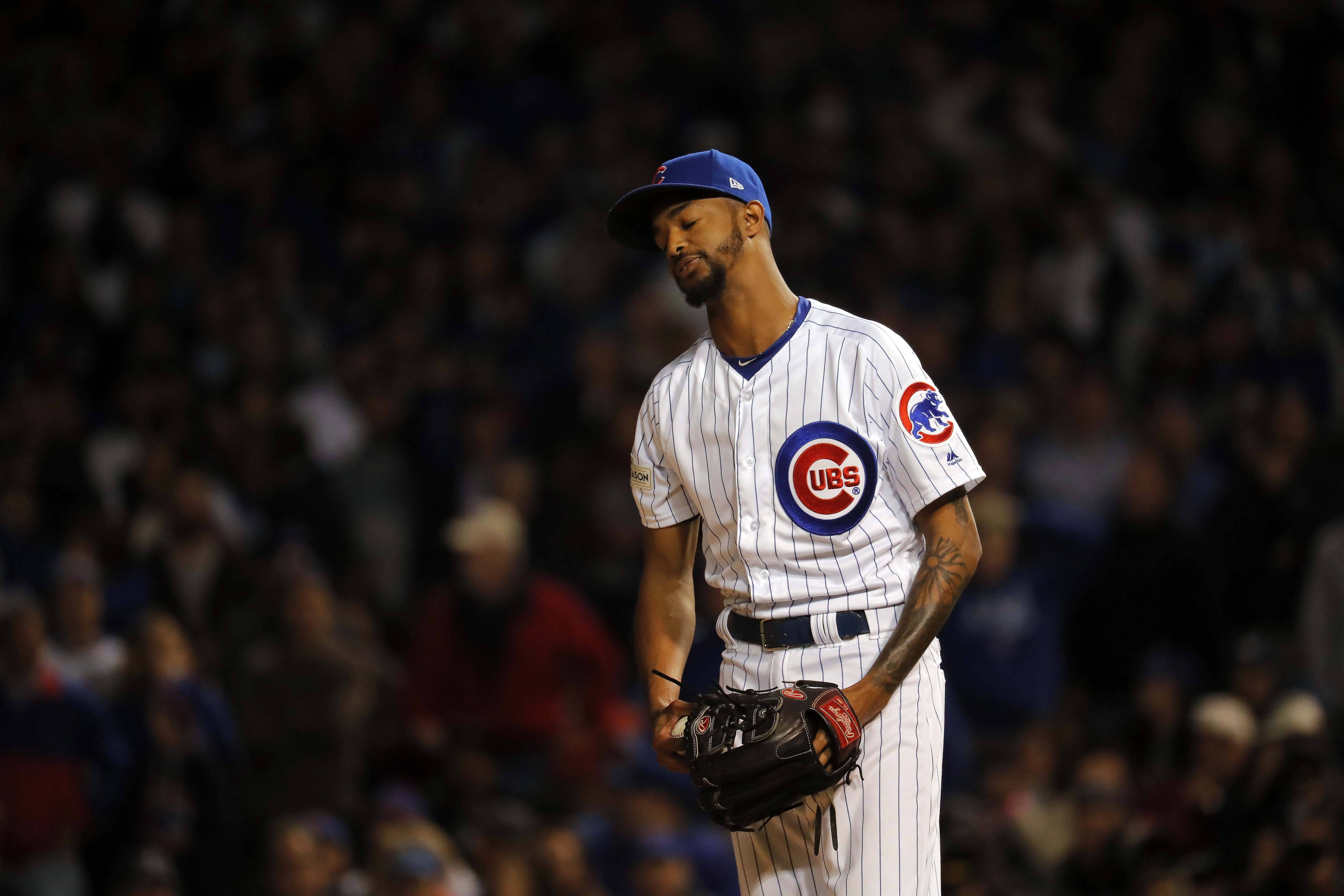 Chicago Cubs relief pitcher Carl Edwards Jr. (6) reacts after walking in a run in sixth inning during Game 3 of the National League championship series, Oct, 17 2017, at Wrigley Field in Chicago.
