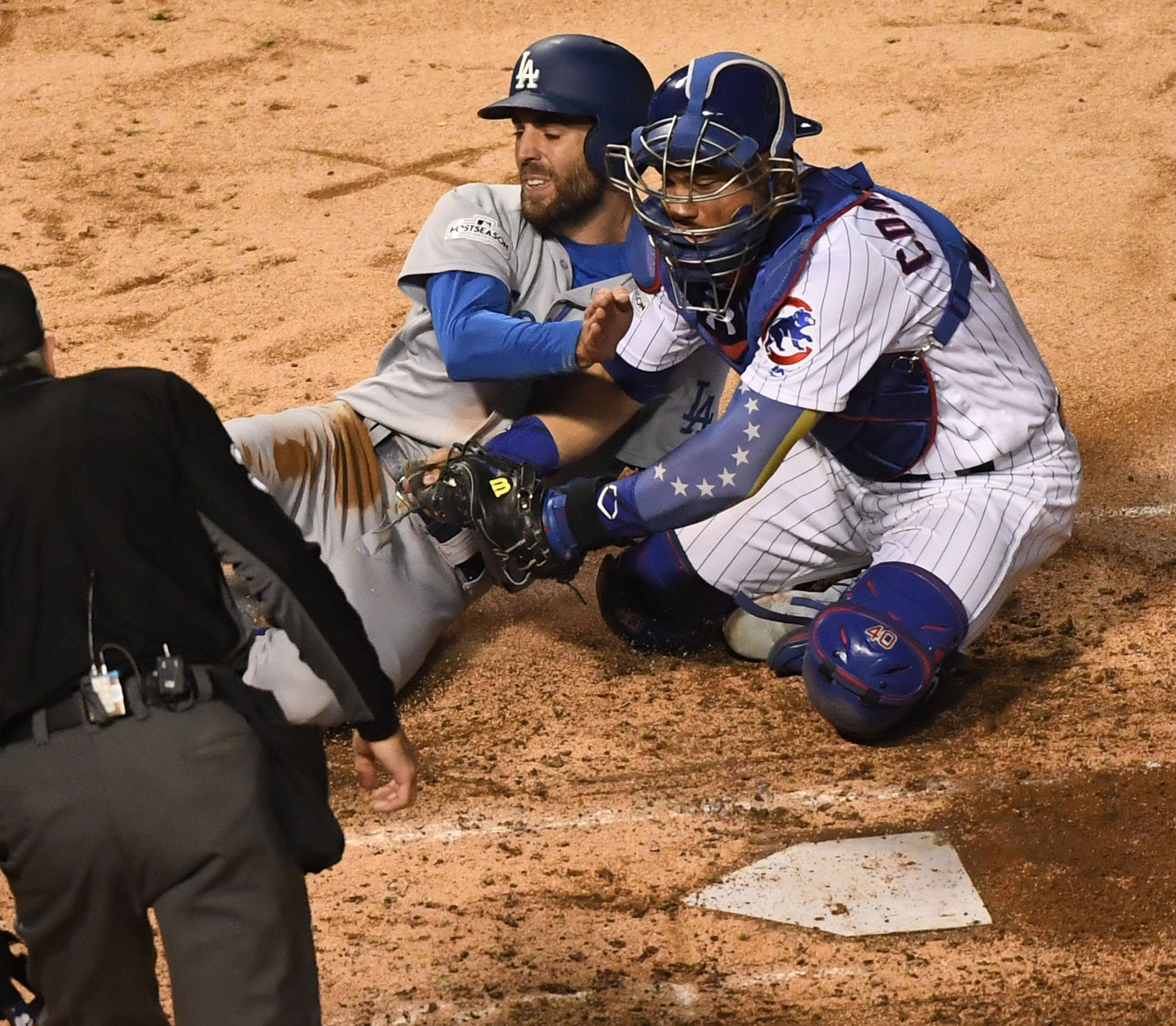 Chicago Cubs catcher Willson Contreras (40) tags out Los Angeles Dodgers center fielder Chris Taylor (3) in the fifth inning during Game 3 of the National League Championship Series, Oct, 17 2017, at Wrigley Field in Chicago.