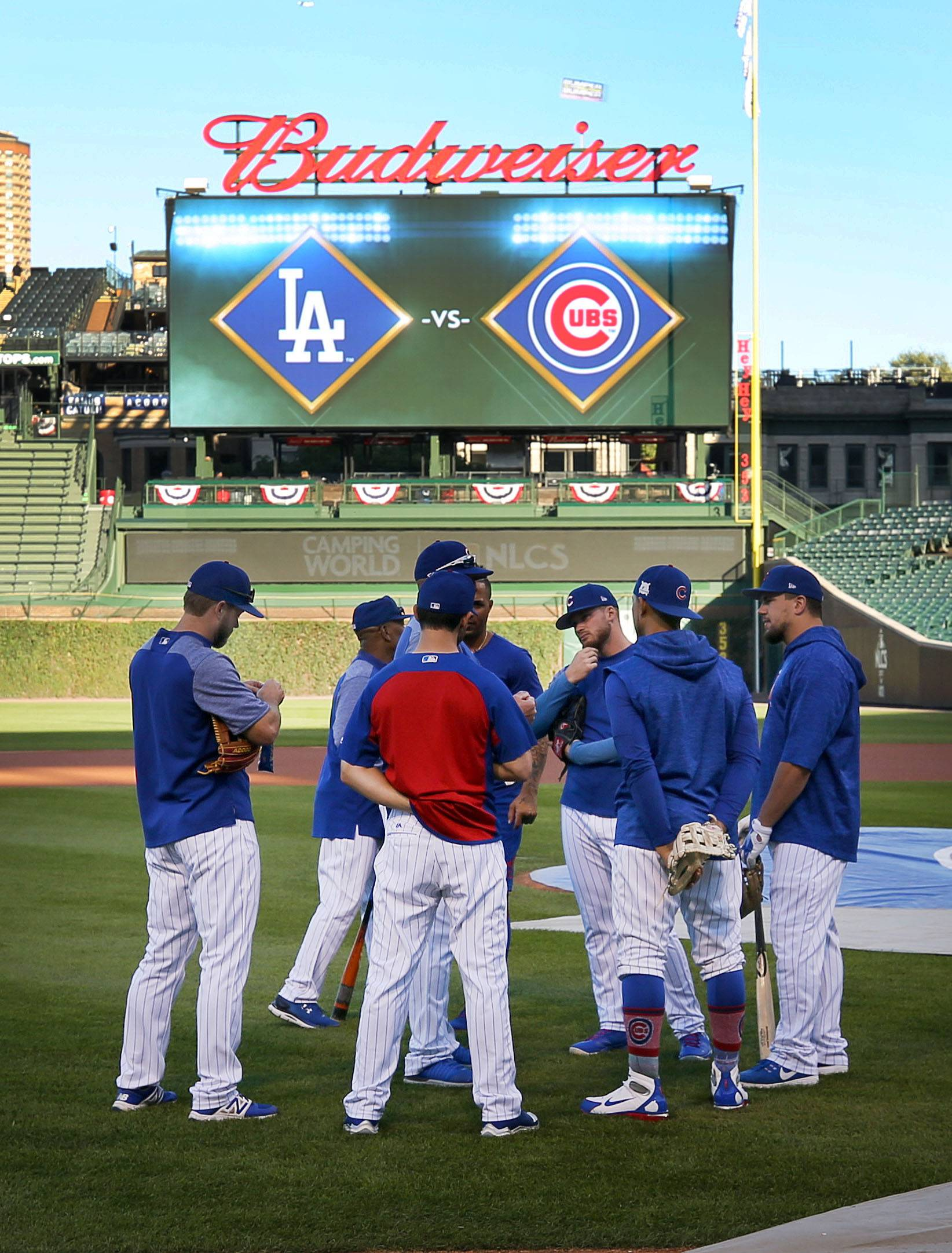 Cubs players talk during batting practice of Game 3 of the National League Championship Series, Oct, 17 2017, at Wrigley Field in Chicago.