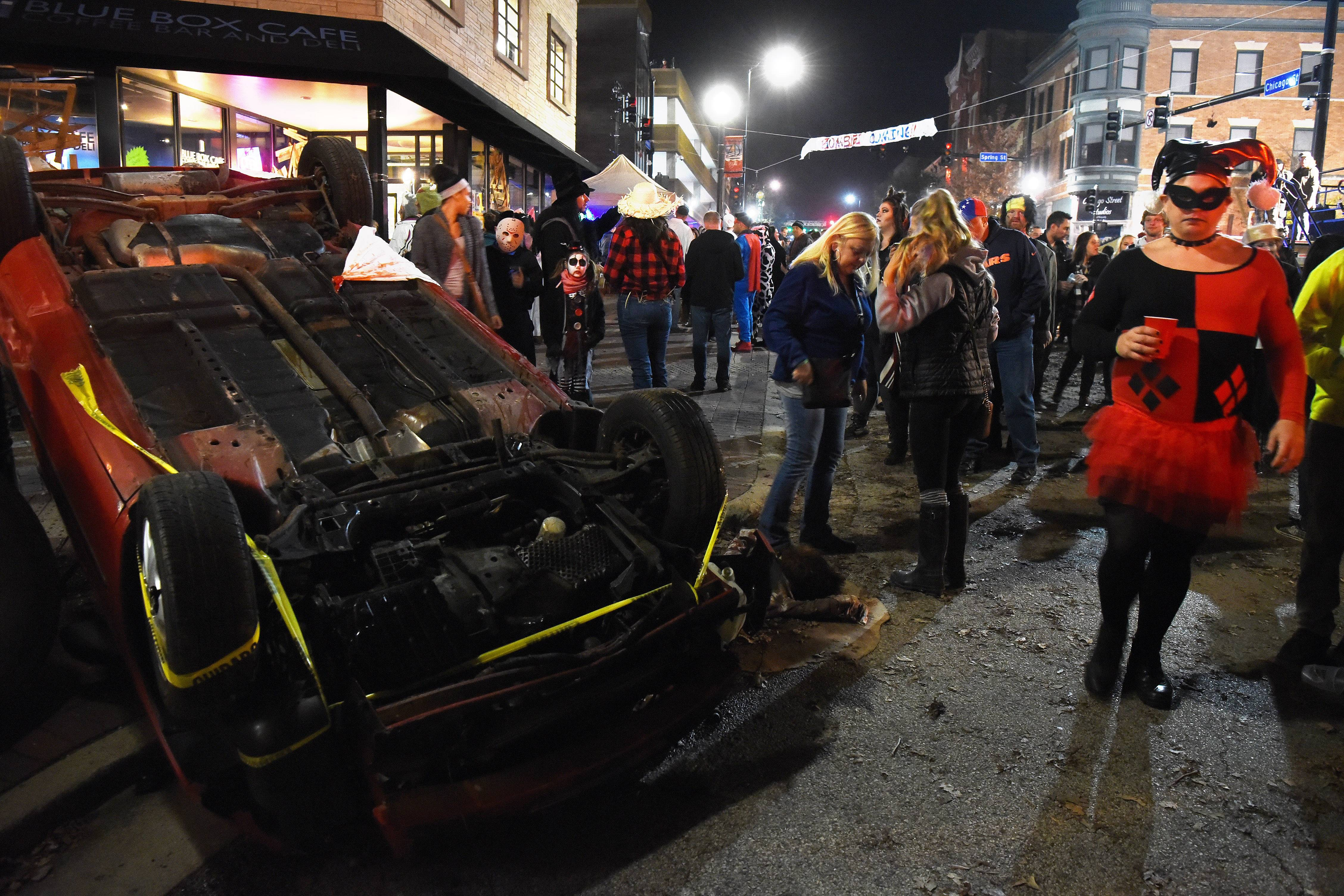 An overturned car sets an apocalyptic scene during last year's Nightmare on Chicago Street in Elgin.