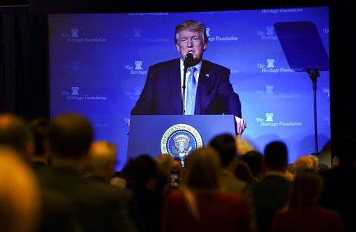 President Donald Trump's image is seen projected on a screen as he speaks at the Heritage Foundation's annual President's Club meeting, Tuesday, Oct. 17, 2017 in Washington. (AP Photo/Pablo Martinez Monsivais)