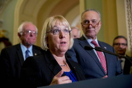 "Sen. Patty Murray, D-Wash., accompanied by Sen. Bernie Sanders, I-Vt., left, and Senate Minority Leader Sen. Chuck Schumer of N.Y., right, speaks to reporters on Capitol Hill in Washington, Tuesday, Oct. 17, 2017, after she and Sen. Lamar Alexander, R-Tenn., say they have the ""basic outlines"" of a bipartisan deal to resume payments to health insurers that President Donald Trump has blocked. (AP Photo/Andrew Harnik)"