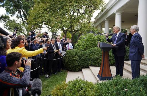 April Ryan, left, the Washington bureau chief for American Urban Radio Networks gestures as she asks questions to President Donald Trump and Senate Majority Leader Mitch McConnell of Ky., in the Rose Garden of the White House, Monday, Oct. 16, 2017. (AP Photo/Pablo Martinez Monsivais)