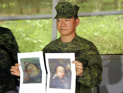 The Latest: Duterte says Marawi liberated, still skirmishes