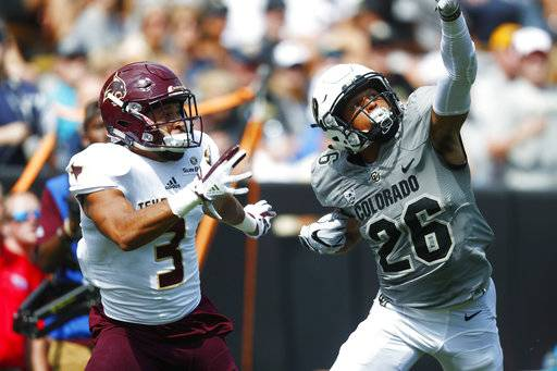 FILE - In this Saturday, Sept. 9, 2017, file photo, Colorado defensive back Isaiah Oliver, right, defects a pass intended for Texas State wide receiver Elijah King in the first half of an NCAA college football game in Boulder, Colo. Oliver has proven to be a standout performer in the Colorado secondary and also happens to be a rising decathlete in track and field. (AP Photo/David Zalubowski, File)