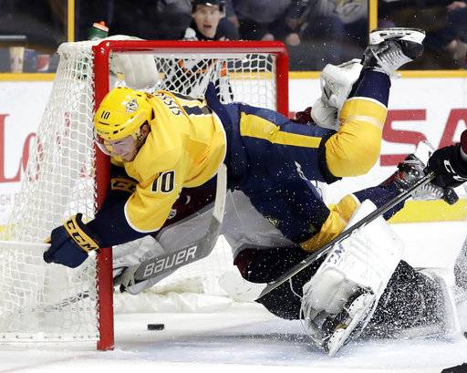 Nashville Predators center Colton Sissons (10) collides with Colorado Avalanche goalie Semyon Varlamov, of Russia, as Sissons scores a goal in the second period of an NHL hockey game Tuesday, Oct. 17, 2017, in Nashville, Tenn. (AP Photo/Mark Humphrey)