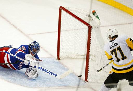 Pittsburgh Penguins center Evgeni Malkin (71) shoots to score past New York Rangers goalie Henrik Lundqvist (30) for the winning goal in overtime of an NHL hockey game, Tuesday, Oct. 17, 2017, in New York. The Penguins won 5-4. (AP Photo/Julie Jacobson)