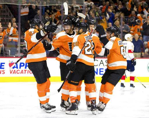 Philadelphia Flyers' Sean Couturier, center left, celebrates his goal with teammates during the second period of an NHL hockey game against the Florida Panthers, Tuesday, Oct. 17, 2017, in Philadelphia. (AP Photo/Chris Szagola)