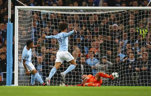 Manchester City's Gabriel Jesus, left, scores a goal during the Champions League group F soccer match between Manchester City and Napoli at the Etihad Stadium in Manchester, England, Tuesday, Oct.17, 2017. (AP Photo/Dave Thompson)