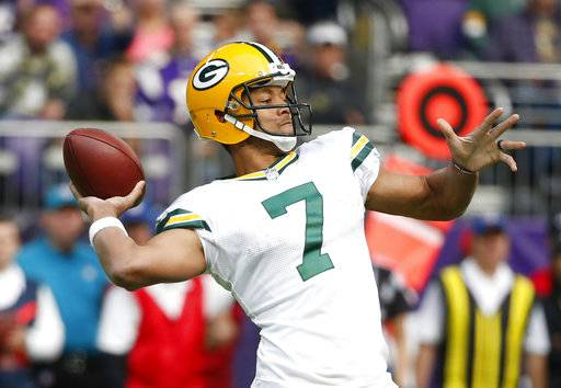 Green Bay Packers quarterback Brett Hundley (7) throws against the Minnesota Vikings in the first half of an NFL football game in Minneapolis, Sunday, Oct. 15, 2017. (AP Photo/Bruce Kluckhohn)