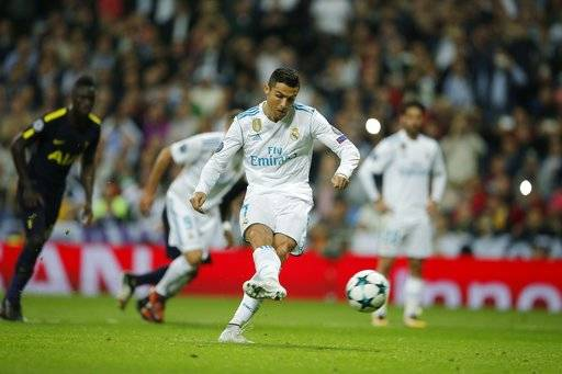 Real Madrid's Cristiano Ronaldo scores from the penalty spot during a Group H Champions League soccer match between Real Madrid and Tottenham Hotspur at the Santiago Bernabeu stadium in Madrid, Tuesday Oct. 17, 2017. (AP Photo/Paul White)