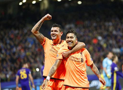 Liverpool's Roberto Firmino, right, celebrates with Dejan Lovren after scoring during the Champions League soccer match between Maribor and Liverpool at the Ljudski vrt stadium, in Maribor, Slovenia, Tuesday, Oct. 17, 2017. (AP Photo/Darko Bandic)