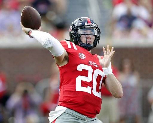 Mississippi quarterback Shea Patterson (20) passes against Vanderbilt in the first half of an NCAA college football game in Oxford, Miss., Saturday, Oct. 14, 2017. (AP Photo/Rogelio V. Solis)