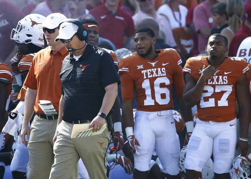 "FILE - In this Oct. 14, 2017, file photo, Texas head coach Tom Herman walks the sidelines as Texas plays Oklahoma during the second half of an NCAA college football game, in Dallas. Midway through a first season most notable for two close losses, an emerging freshman quarterback and an off-hand ""fairy dust� comment, Tom Herman has a 3-3 team that's not really any closer to reaching a bowl game than Charlie Strong's last one was. (AP Photo/Ron Jenkins, File)"