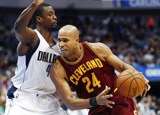 FILE - In this Monday, Jan. 30, 2017 file photo, Cleveland Cavaliers forward Richard Jefferson (24) battles Dallas Mavericks forward Harrison Barnes (40) for space during the first half of an NBA basketball game in Dallas. Their roster overloaded, the Cavaliers are trading Richard Jefferson and Kay Felder to save money. Cleveland has agreed to send Jefferson, Felder, two second-round draft picks and $3 million to the Atlanta Hawks in a move that will allow the Eastern Conference champions to avoid paying $12 million in luxury tax penalties, a person familiar with the deal told The Associated Press on Friday, Oct. 13, 2017. (AP Photo/Brandon Wade, File)