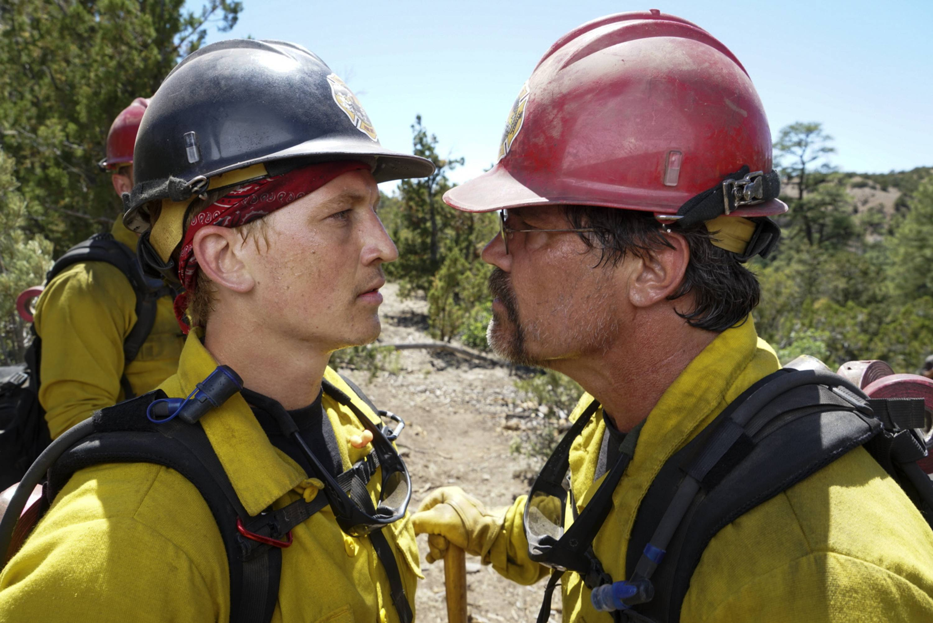 "Superintendent Eric Marsh (Josh Brolin), right, reads the riot act to new firefighter recruit Brendan ""Donut"" McDonough (Miles Teller) in the fact-based drama ""Only the Brave."""