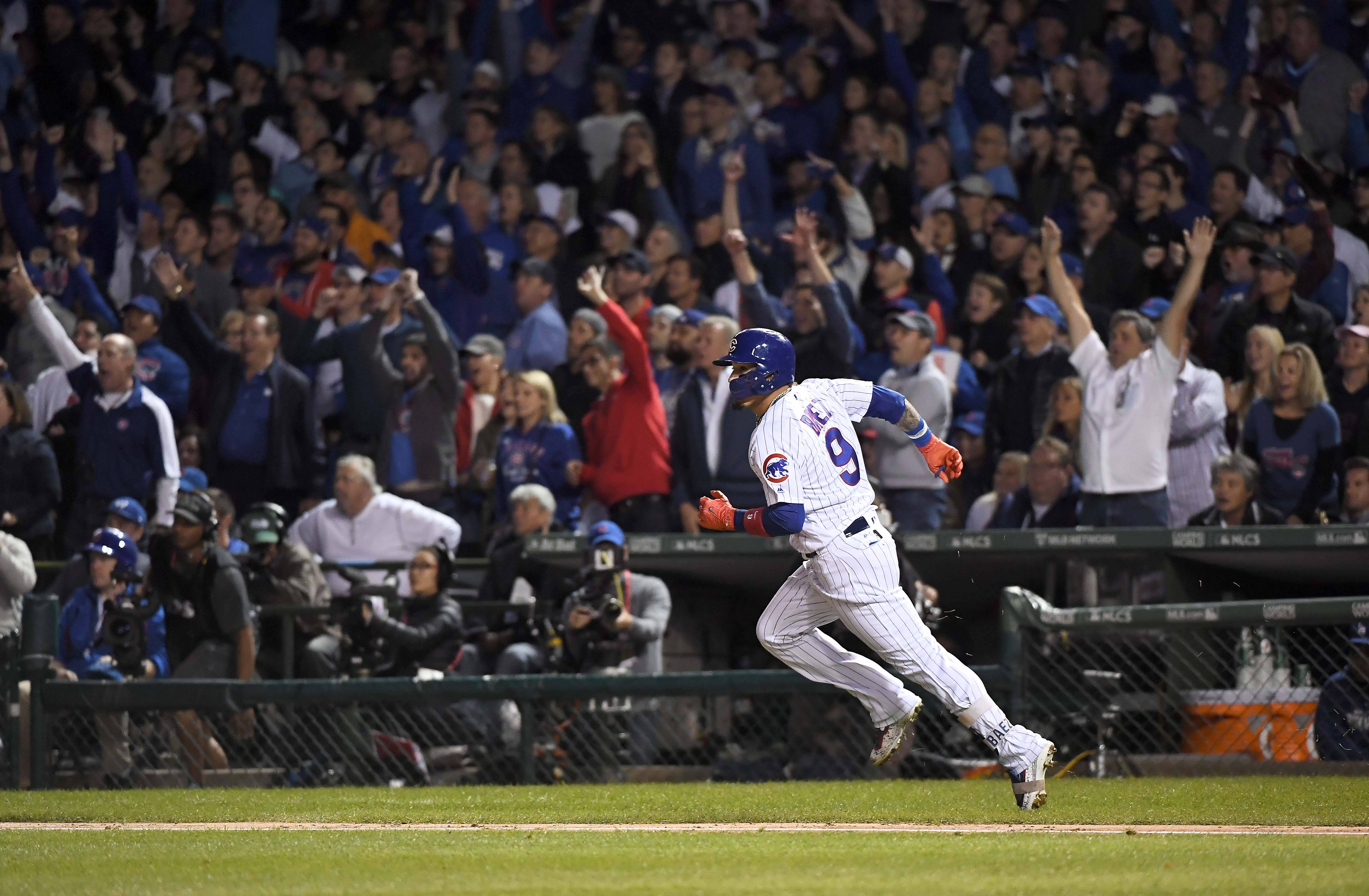 Chicago Cubs second baseman Javier Baez and the Wrigley Field fans watch his home run in the 5th inning during Game 4 of the National League championship series.