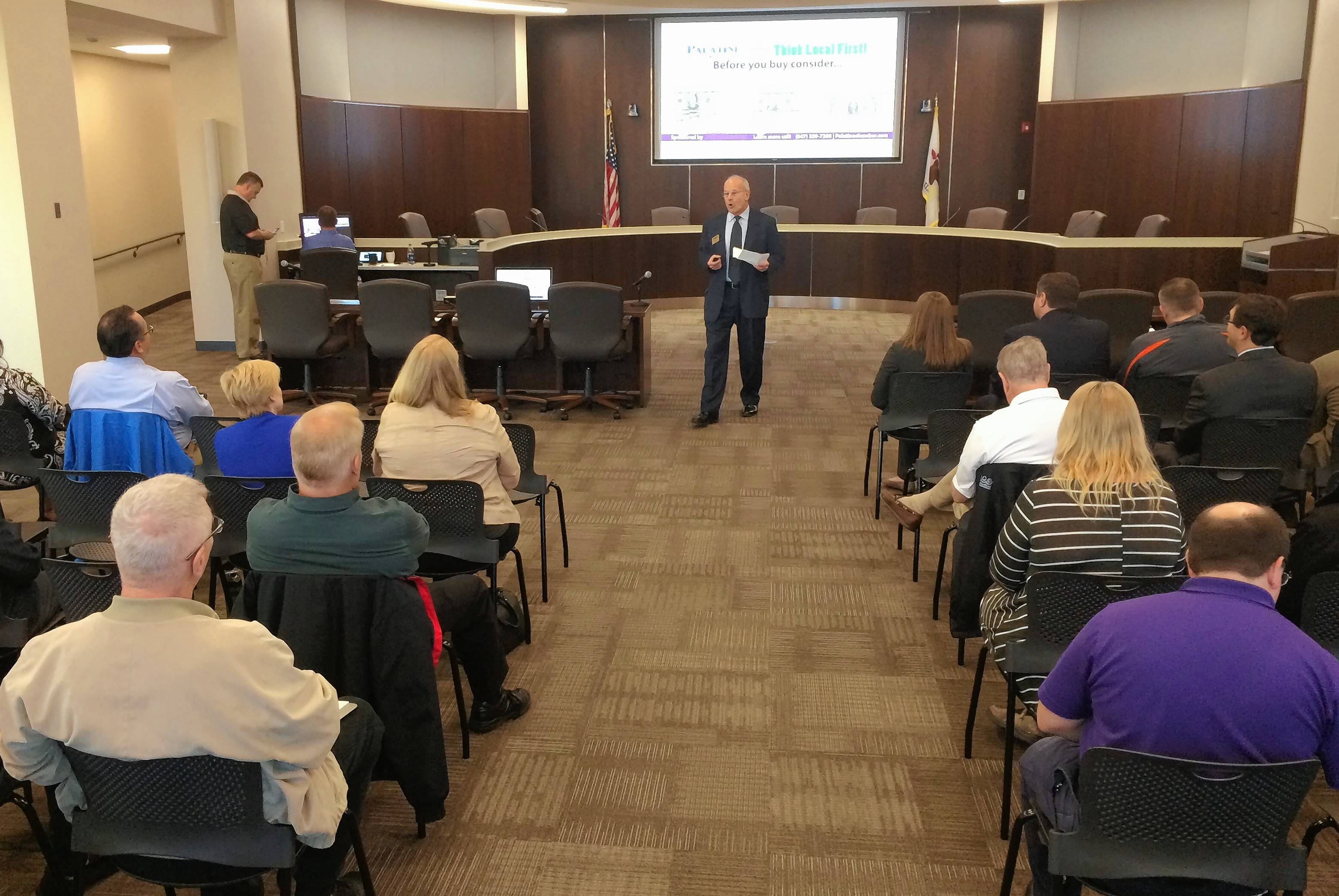 Palatine Area Chamber of Commerce Executive Director Steven Gaus welcomes the crowd Wednesday to a community forum with eight local governments. It was held at Palatine village hall.